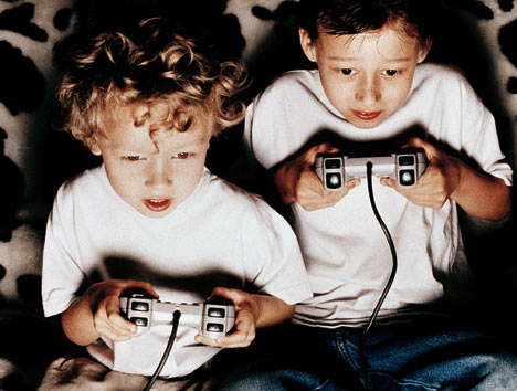 two young boys playing video games